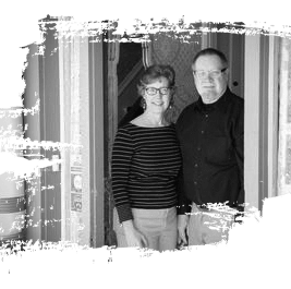 An image of the two innkeepers in the front doorway of their amazing bed and breakfast