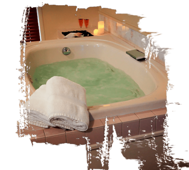 The bathroom inside the Nautical Suite has an amazing Jacuzzi ready with towels and candles