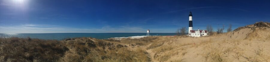 view of dunes and Big Sable lighthouse in distance