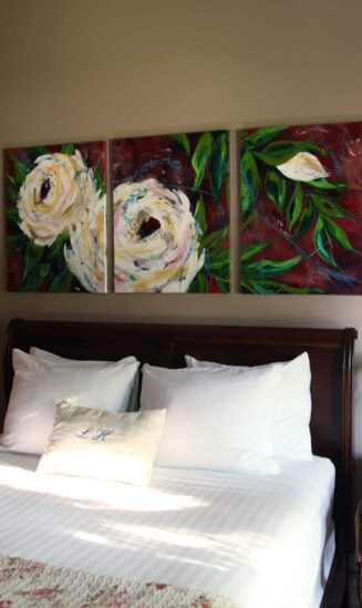 view of bed with artwork behind