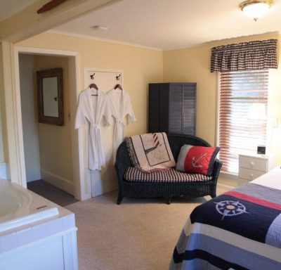 The nautical suite has two robes hanging on the wall to be used for the in room jacuzzi