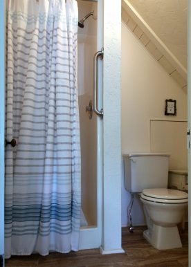 small bathroom contains shower and toilet