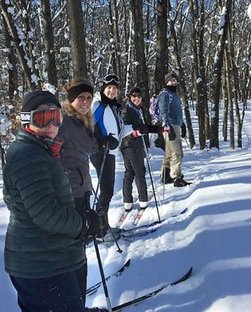 Friends lining up for a snow shoe in mid winter
