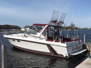 The boat sits on the lake ready to be taken out for a charter