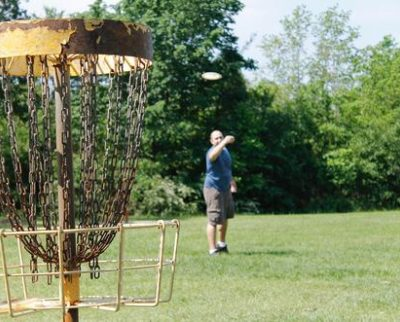 a person playing disc golf